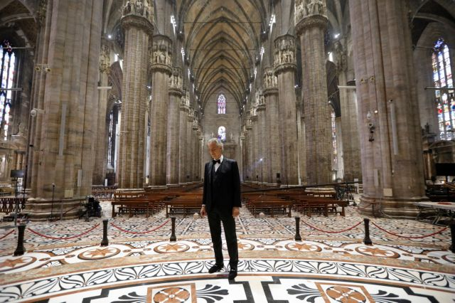 Italian opera singer Andrea Bocelli prepares for the ''Music for hope'' event, a streamed live performance intended as a symbol of love, hope and healing amidst the coronavirus disease (COVID-19) outbreak, on Easter Sunday, at an empty Duomo Cathedral in Milan, Italy, April 12, 2020. Luca Rossetti/Courtesy Sugar Srl/Decca Records/Handout via REUTERS  THIS IMAGE HAS BEEN SUPPLIED BY A THIRD PARTY. MANDATORY CREDIT. NO RESALES. NO NEW USAGE USE AFTER 23:59 GMT ON DECEMBER 31, 2020. IMAGE MUST BE USED IN ITS ENTIRETY - NO CROPPING OR OTHER MODIFICATIONS.